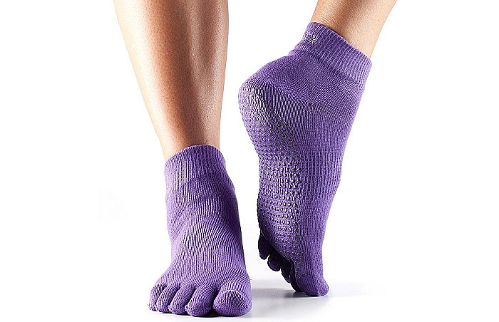 ToeSox are legendary. Awesome grip and freedom is what makes them the best men's socks for yoga with five separate toes.