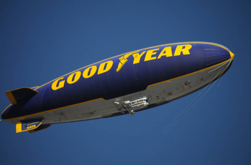 The Goodyear blimp traveling in the air