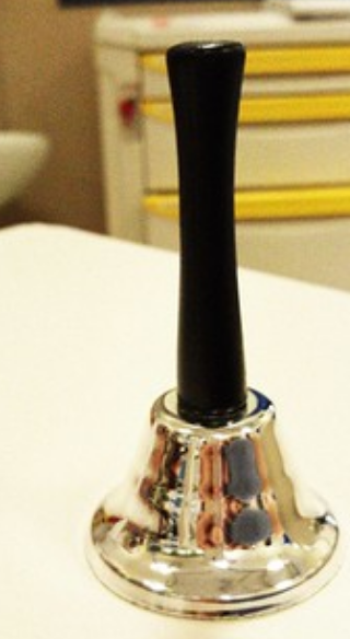 Hand Bell on Desk